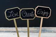 Business message LIVE CREATE ENJOY Stock Photos