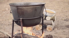 Cooking soup with lamb in a cauldron Stock Footage