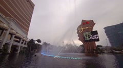 Fountains and flame jets in performance lake at Wynn Macau Resort and Casino Stock Footage