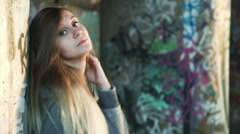 Girl near the wall with graffiti Stock Footage