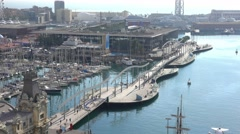 Rambla de Mar bridge and Maremagnum in Barcelona Stock Footage
