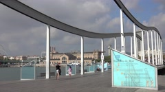 Pedestrian Bridge Rambla de Mar in Barcelona Port Vell Stock Footage