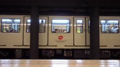 Barcelona metro train departs from platform - Barcelona Underground station Stock Footage
