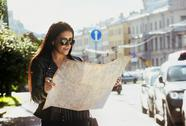 Pretty girl stands with city map Stock Photos