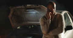 4k, A man phoning roadside assistance because his car has broken down at night. Stock Footage