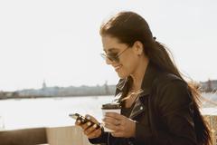 Closeup portrait girl coffee to go mobile Stock Photos