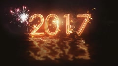 Happy New Year 2017 inscription sparklers on a black background . Fireworks on Stock Footage