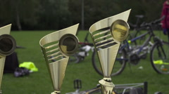 Golden Cups Award in local school cup cycle sport in Prague public park. Stock Footage