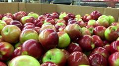 Woman's hand picking apple inside Walmart store Stock Footage