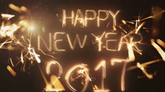 Happy New Year 2017 inscription sparklers on a black background Stock Footage