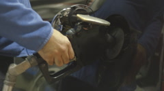 Filling up gas tank with fuel Stock Footage