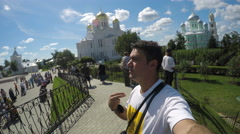 Tourist selfie praying on Cathedral Square in Holy Trinity Seraphim-Diveevo Stock Footage