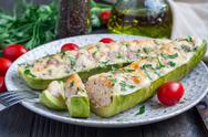 Zucchini boats stuffed with ground meet on a plate, horizontal Stock Photos