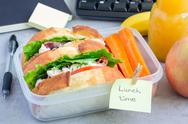 Lunch box with chicken salad sandwiches and carrot sticks, horizontal Stock Photos