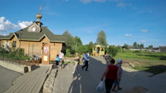 Unknown pilgrims are on territory of Holy Trinity Seraphim-Diveevo monastery Stock Footage