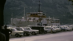 Kotor, Yugoslavia 1972: cars parked in front of the port Stock Footage