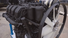 Powerful, black 8-cylinder engine for a military armored heavy vehicle Stock Footage