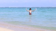 Young happy woman playing in ocean, splashing the water, slow motion, full hd Stock Footage