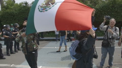 Protesters hold Mexico Flag -  Donald Trump Rally - Anaheim, CA - May 25th, 2016 Stock Footage