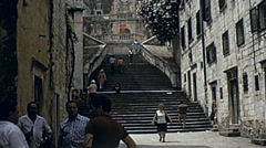 Dubrovnik, Yugoslavia 1972: people walking downtown Stock Footage