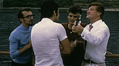 Kotor, Yugoslavia 1972: musicians during a guided tour on a boat Stock Footage