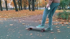 Skater picks up skateboard drops out of the hands pick up again and continue Stock Footage