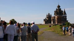 Tourists on excursion on Kizhi Island in Russia Stock Footage