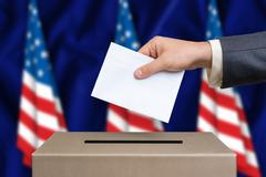 Election in United States of America. The hand of man putting his vote in the Stock Photos