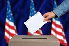 Election in United States of America. The hand of woman putting her vote in t Stock Photos