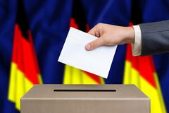 Election in Germany. The hand of man putting his vote in the ballot box. Germ Stock Photos