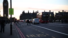 Traffic on Westminster Bridge at dusk in London Stock Footage