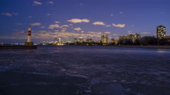 Chicago: Skyline with Icy Lake Michigan at Night Stock Footage