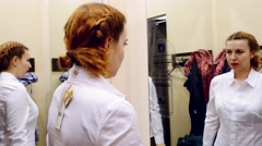 Beautiful Woman try cloth in dressing room.  Stock Footage
