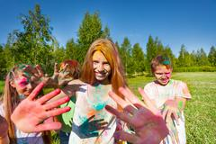 Girl on color festival smeared with colored powder Stock Photos