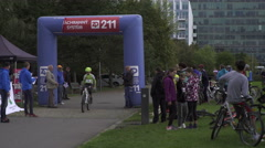 Finish of the 3 first teen- age winners in Cycle sport Cups Award in social park Stock Footage