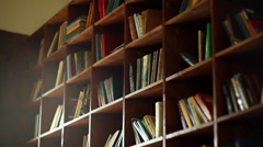 Bookshelves in university library with lots of books Stock Footage