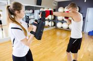 Boxer Punching Bag Held By Female Instructor Stock Photos