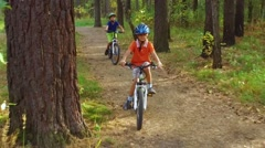 Boys riding their bicycles in forest Stock Footage