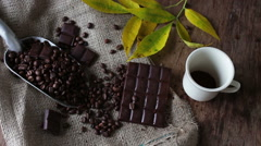 Coffee Grains chocolate and cup of coffee Stock Footage