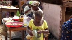 Africa girl preparing caju juice to sell - Guinea Africa Stock Footage