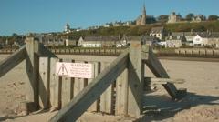 Groynes on Lossiemouth beach, Scotland Stock Footage