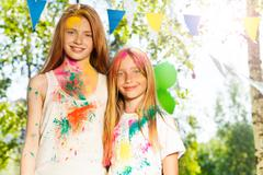 Two beautiful girls smeared with colored powder Stock Photos