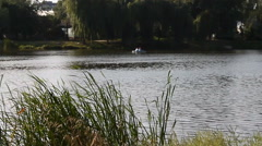 People sail on small boat quiet morning on the Lake Stock Footage