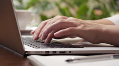 Woman typing on the  laptop computer. Hight quality sliding shot, UHD, 4K Stock Footage