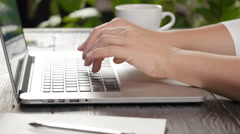 Woman's hands typing on a laptop keyboard Stock Footage