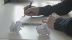 Man writing ideas on paper and crumple paper Stock Footage
