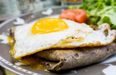 Homemade french buckwheat galette with egg Stock Photos