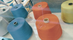 Rows spools of thread of different colors in the industrial sewing machine Stock Footage