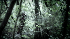 4k Halloween Shot of a Child in Joker Costume Running in the Forest Stock Footage