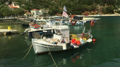 Fishing boats in Frikes harbour on the Greek island of Ithaca. Stock Footage